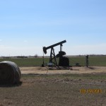 Oil Well and Haystack Outside Russell, Kansas