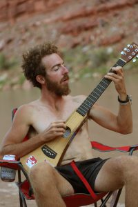 Jamming at camp in Cataract Canyon on the Colorado River